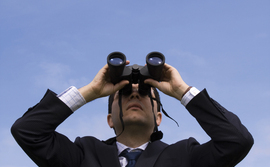man-with-binoculars-270x167
